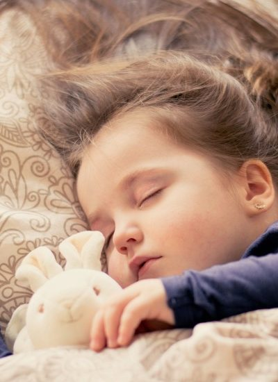 Child Sleeping in Bed with Stuffed Animal - A Bedtime Routine to Help Your Child Sleep