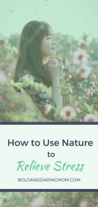 Woman Stress Free in Field of Flowers with Title Overlay of How to Use Nature to Relieve Stress - Natural stress relievers, fun stress relieving activities, reduce stress naturally, outdoors and mental health